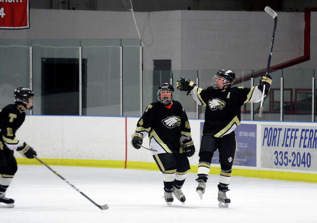Trumbull's #9 A.J. DiMasi, right, celebrates after scoring a goal against Fairfield Warde/Ludlowe, during boys hockey action at the Wonderland of Ice in Bridgeport, Conn. on Wednesday January 30, 2013. Photo: Christian Abraham / Connecticut Post