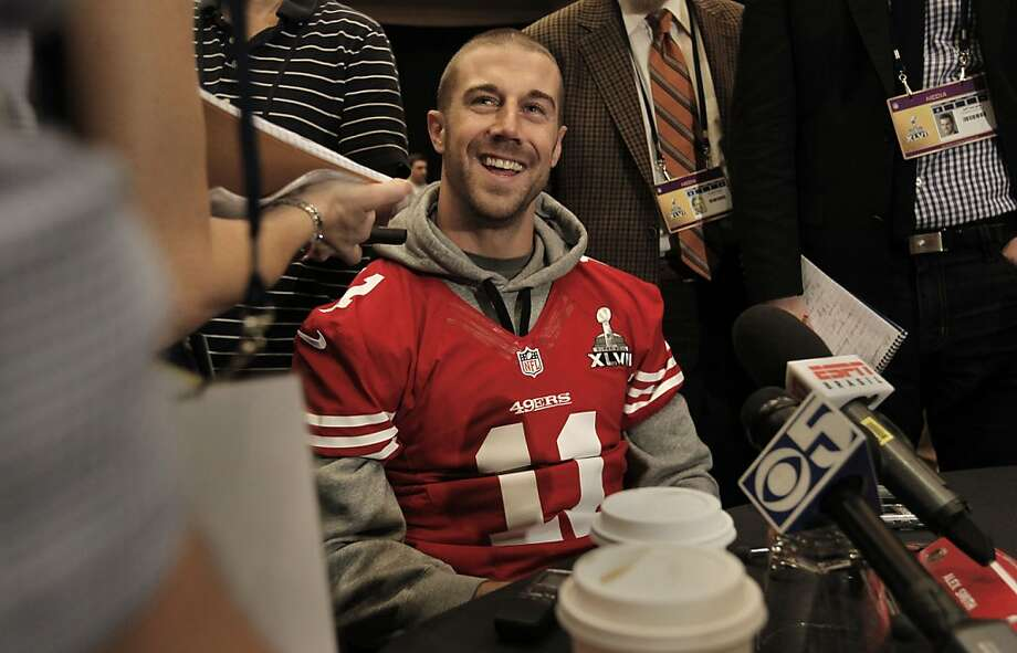 49er quarterback Alex Smith, 11, stays loose and smiles as he speaks with reporters during the daily press conference for the San Francisco 49ers on Wednesday January 30, 2013 in New Orleans, La., as the two teams the Baltimore Ravens and the San Francisco 49ers prepare for this Sunday's NFL Superbowl game. Photo: Michael Macor, The Chronicle