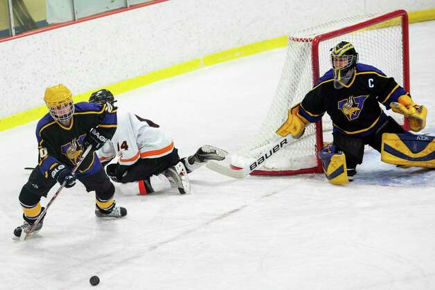 Westhill high school's Matthew Abt tries to clear the puck during a boys ice hockey game against Stamford high school played at Terry Conners Rink Stamford CT. on Wednesday January 30th 2013. Photo: Mark Conrad / Stamford Advocate Freelance