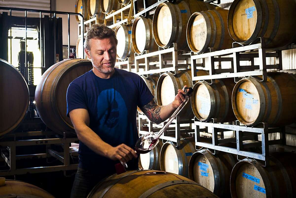 Matthew Rorick of Forlorn Hope uses a thief to get a taste of a 2012 Barbera on Sunday, Jan. 13, 2013.