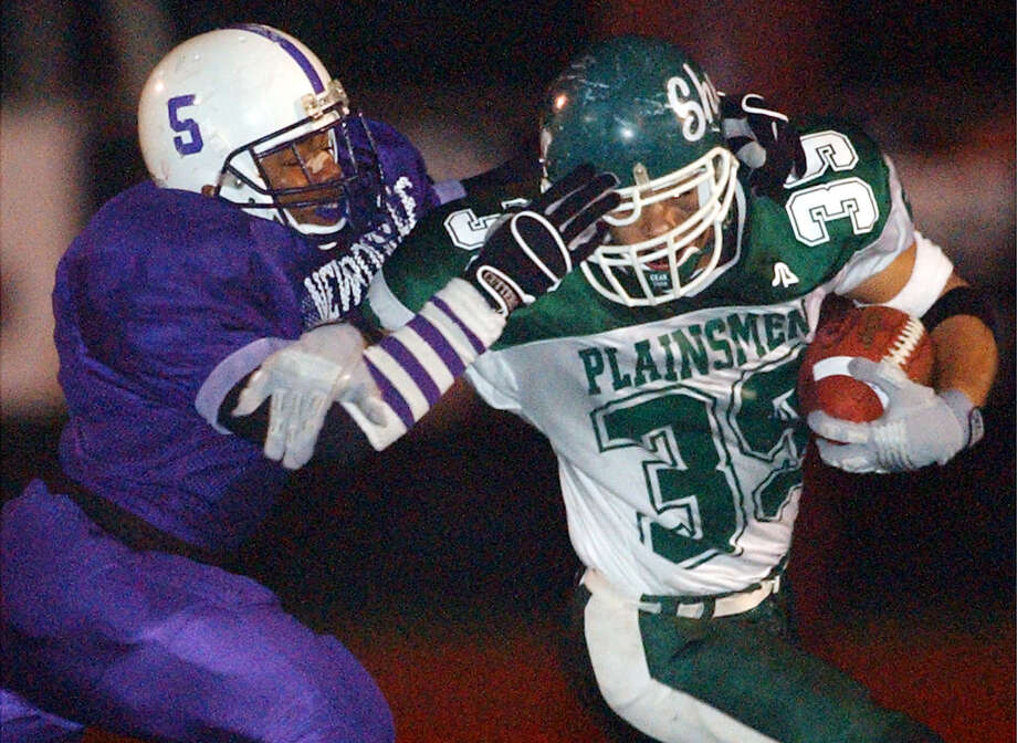 Times Union Photo by James Goolsby Nov.21, 2003-Shen #39-RB-Isaac Williams is chased by New Rochelle #5-Raymell Rice. In the second half of the Class AA State Semifinal game in Kingston N.Y. Photo: JAMES GOOLSBY / ALBANY TIMES UNION