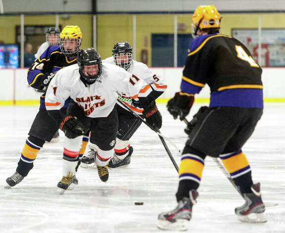 Stamford high school's Justin Nizolek moves the puck up ice in a boys ice hockey game against Westhill high school played at Terry Conners Rink Stamford CT. on Wednesday January 30th 2013. Photo: Mark Conrad / Stamford Advocate Freelance