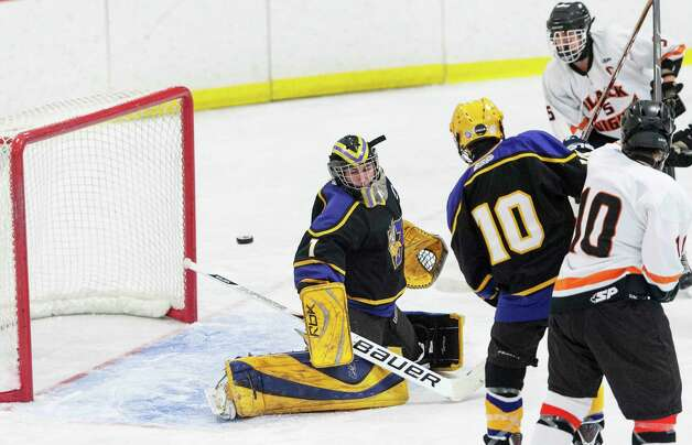 Westhill high school goalie Tyler Phillipson makes a save during a boys ice hockey game against Stamford high school played at Terry Conners Rink Stamford CT. on Wednesday January 30th 2013. Photo: Mark Conrad / Stamford Advocate Freelance