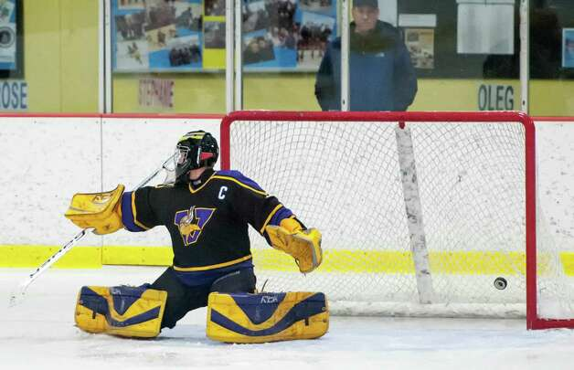 Westhill high school goalie Tyler Phillipson cant make a save on a shot by Stamford high school's Justin Nizolekduring a boys ice hockey game played at Terry Conners Rink Stamford CT. on Wednesday January 30th 2013. Photo: Mark Conrad / Stamford Advocate Freelance