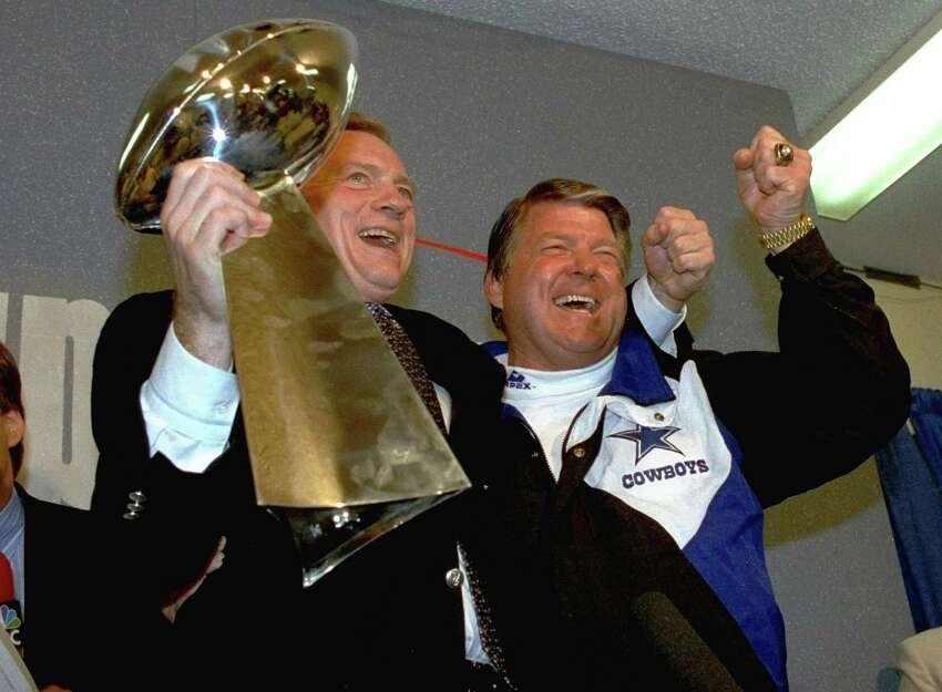 In this Jan. 31, 1993 file photo, Dallas Cowboys head coach Jimmy Johnson, right, and owner Jerry Jones, hold up the Vince Lombardi Trophy as they celebrate their 52-17 win over the Buffalo Bills in Super Bowl XXVII in Pasadena, Calif. Johnson made 51 trades in his five years in Dallas,
