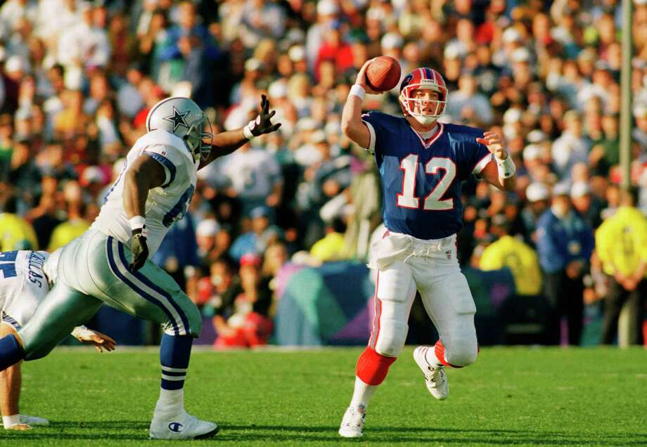 Buffalo Bills quarterback Jim Kelly is chased by Dallas Cowboys Russe Maryland during the first quarter of Super Bowl XXVII in Pasadena, Sunday, Jan. 31, 1993. Photo: Associated Press