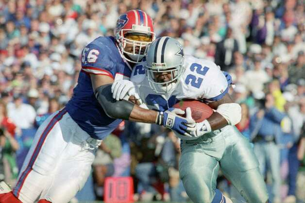 Dallas Cowboys'  Emmitt Smith (22) gains yardage on Buffalo Bills Darryl Talley during first quarter Super Bowl action in Pasadena, Calif., Sunday, Jan. 31, 1993. Photo: Rick Bowmer, Associated Press / AP1993