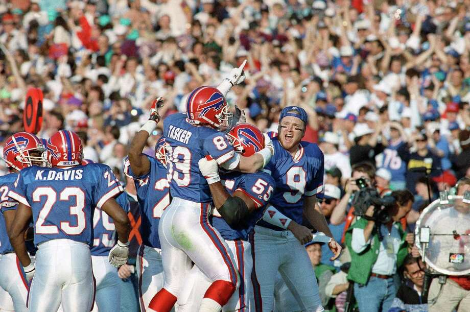 Buffalo Bills wide receiver Steve Tasker, left, is congratulated by teammates Mark Maddox and punter Chris Mohr, right, after blocking a Cowboy punt the first quarter of the Super Bowl, Sunday, Jan. 31, 1993 in Pasadena. Photo: David Longstreath, Associated Press / AP1993