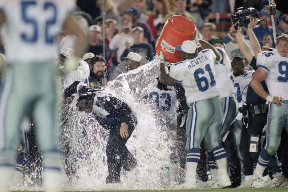 Dallas Cowboys Coach Jimmy Johnson is drenched by team members including Nate Newton during the closing moments of Dallas and Buffalo Bills  Super Bowl in Pasadena, Calif., Sunday, Jan 31,1993. The Cowboys won 52-17. Photo: DOUG MILLS, Associated Press / 1993 AP
