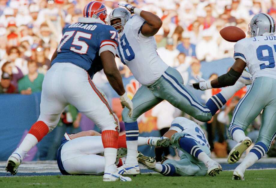 Dallas cowboys Leon Lett (78) flies past the ball after a fumble by Buffalo Bills quarterback Jim Kelly (on ground). The ball was recovered by Cowboys Jimmie Jones (97) for the first quarter touchdown in the Super Bowl on Sunday,  Jan. 31, 1993 in Pasadena, Calf. At left is Bills Howard Ballard. Photo: Eric Risberg, Associated Press / AP1993
