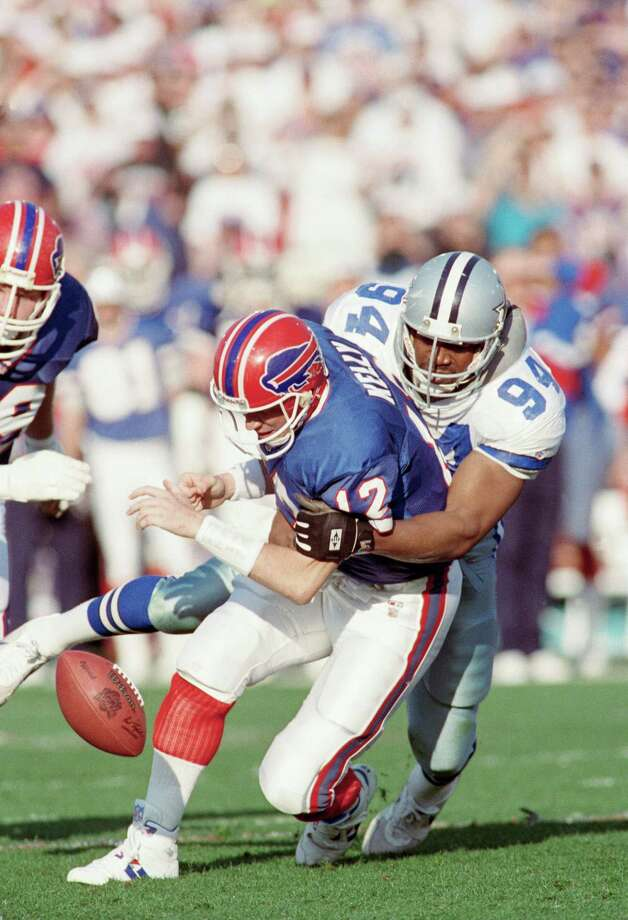Buffalo Bills quarterback Jim Kelly has the ball striped by Dallas Cowboys Charles Haley during first quarter of Super Bowl Sunday, Jan. 31, 1993 Pasadena, Calif.  Play was nulified by holding call and Buffalo was awarded the ball first and goal. Photo: Rusty Kennedy, Associated Press / AP1993