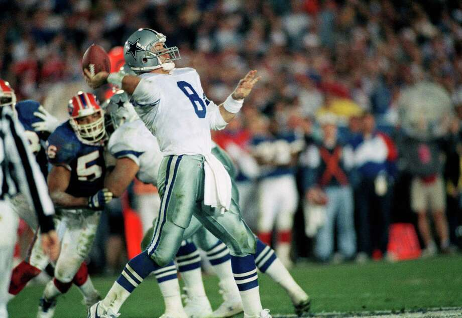 Dallas Cowboys quarterback Troy Aikman prepares to release a fourth-quarter pass in Super Bowl action against the Buffalo Bulls on Sunday, January 31, 1993 in Pasadena, Calif. Aikman, with four touchdown passes, was named the Most Valuable Player in the Cowboys 52-17 victory. Photo: Susan Ragan, Associated Press / 1993 AP