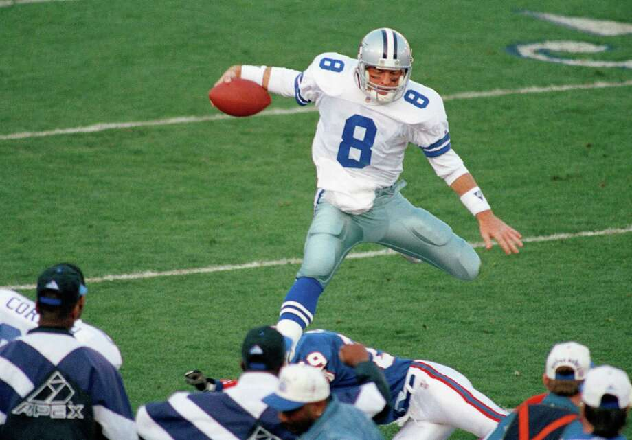 Dallas Cowboys quarterback Troy Aikman goes airborne for a second-quarter gain on Sunday, January 31, 1993 in Super Bowl action in Pasadena, California. The Cowboys won 52-17 against the Buffalo Bills. Photo: Reed Saxon, Associated Press / 1993 AP
