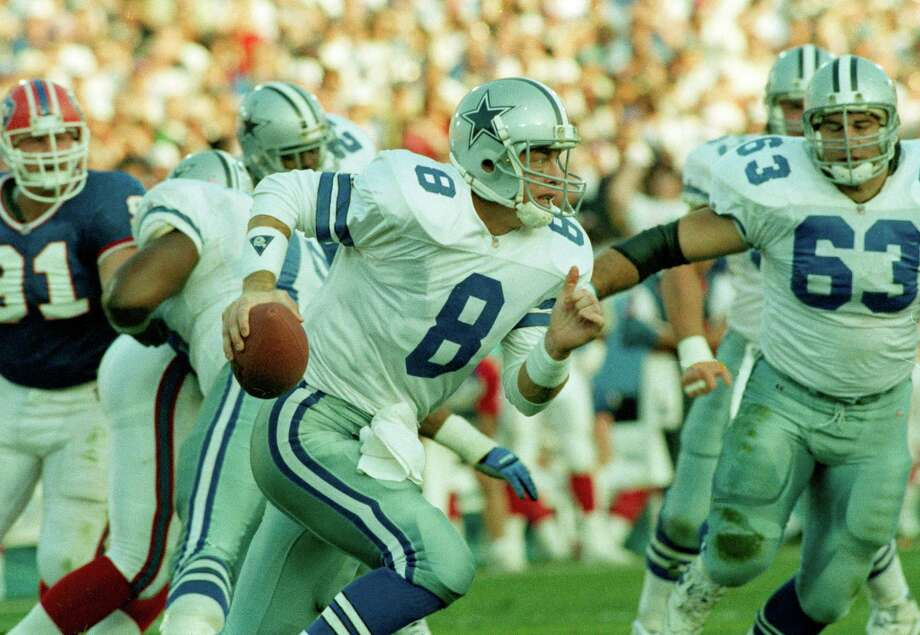 Dallas Cowboys' quarterback Troy Aikman scrambles during the first quarter in the Super Bowl in Pasadena, Calif., Jan. 31, 1993.  The Cowboys defeated the Buffalo Bills, 52-17. Photo: Susan Ragan, Associated Press / 1993 AP