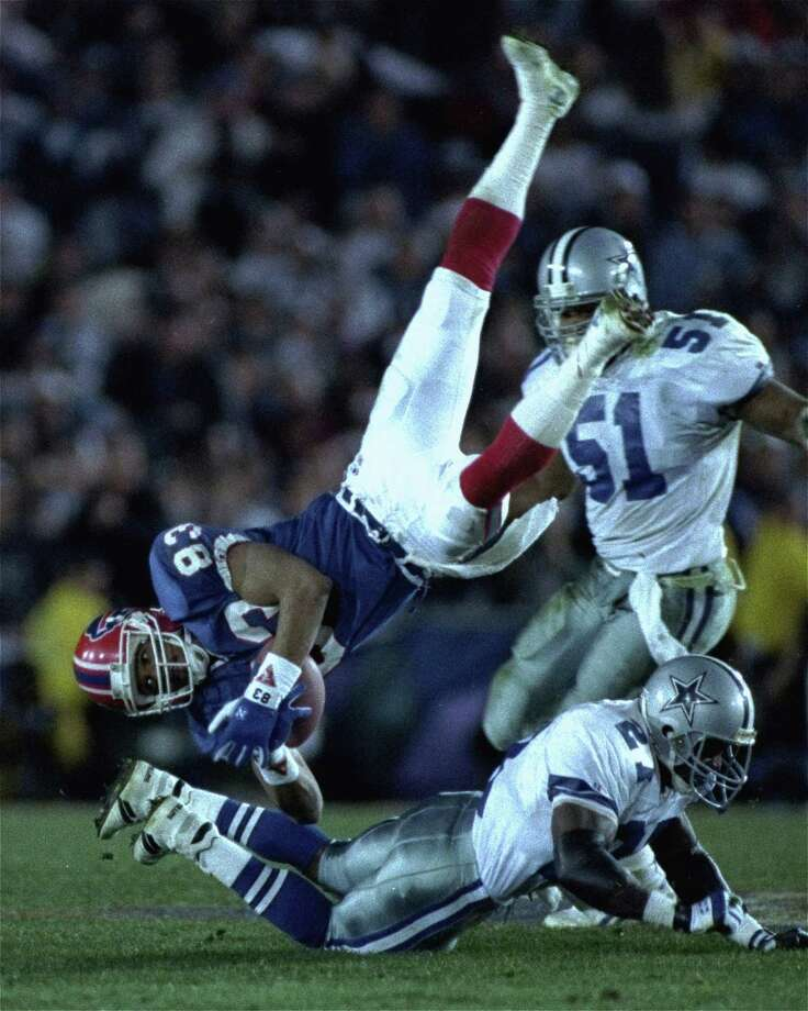 Buffalo Bills wide receiver Andre Reed is upended by Dallas Cowboys strong safety Thomas Everett after a 13 yard reception in the third quarter of Super Bowl XXVII, Sunday, January 31, 1993 in Pasadena.  Dallas won 52-17. Photo: DOUG MILLS, Associated Press / 1993 AP