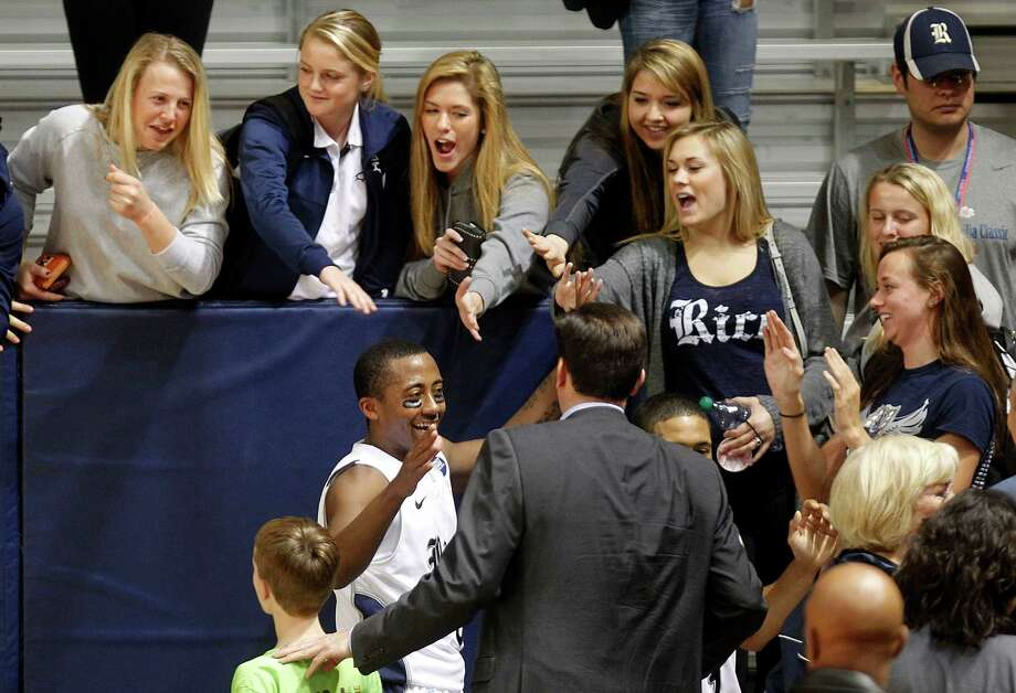 Rice University's Keith Washington celebrates his teams 79-69 win. Photo: Johnny Hanson, Houston Chronicle / © 2013  Houston Chronicle
