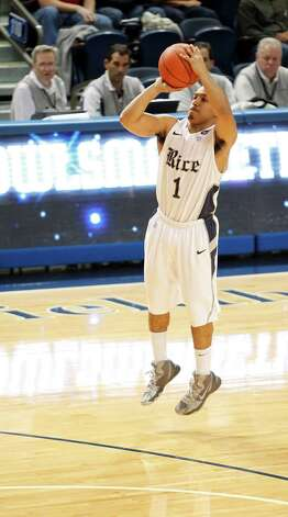 Rice University's Max Guercy shoots a three-point basket. Photo: Johnny Hanson, Houston Chronicle / © 2013  Houston Chronicle