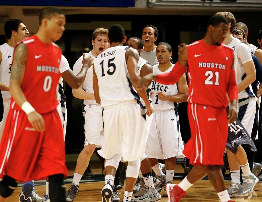 The Rice University bench celebrates a basket by Julian DeBose (15). Photo: Johnny Hanson, Houston Chronicle / © 2013  Houston Chronicle