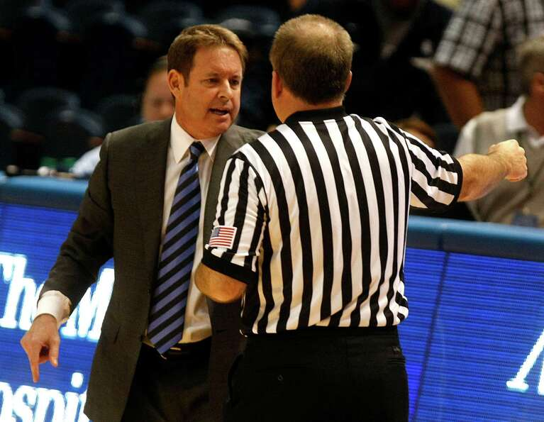Rice University's coach Ben Braun talks to a referee about a foul.