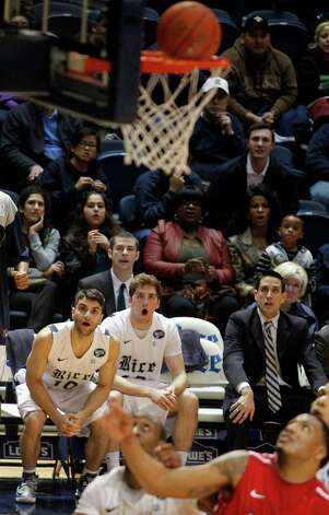 Rice University's Dan Peera, left, and Austin Ramljak, right, watch as a basket by teammate Max Guercy goes in. Photo: Johnny Hanson, Houston Chronicle / © 2013  Houston Chronicle