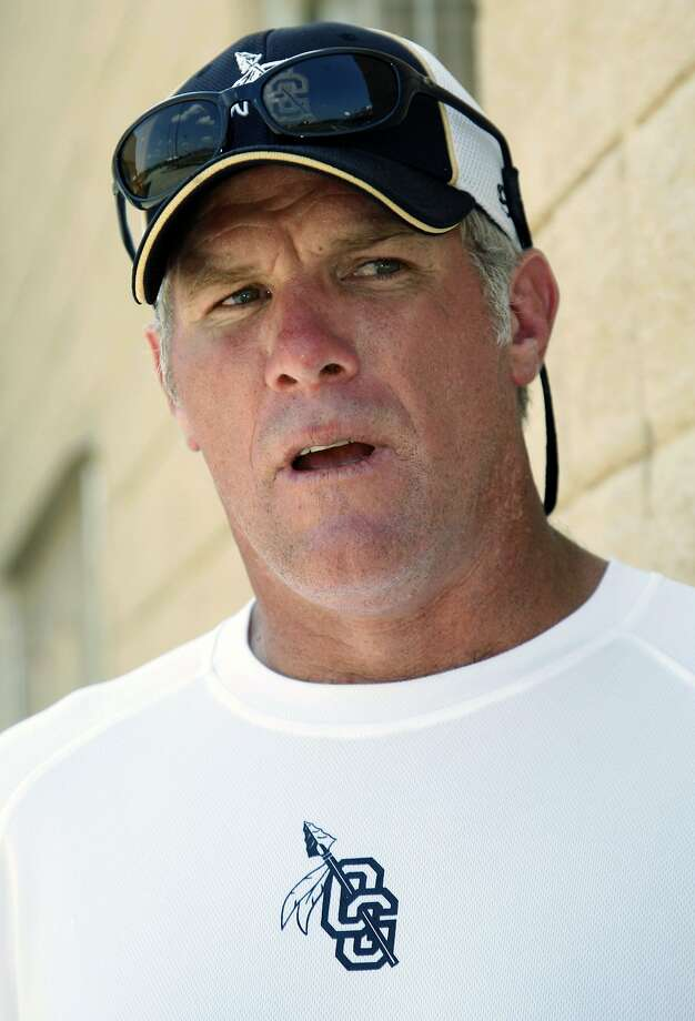 FILE - In this July 30, 2012, file photo, former NFL quarterback Brett Favre, now an assistant football coach at Oak Grove High School in Hattiesburg, Miss., speaks about the transition from player to coach during the first day of official practice for the fall high school football season.  The retired three-time Super Bowl MVP quarterback will join the NFL Network's crew for daylong coverage on Sunday for Super Bowl XLVII between the Baltimore Ravens and San Francisco 49ers. AP Photo/Rogelio V. Solis, File) Photo: Rogelio V. Solis, Associated Press