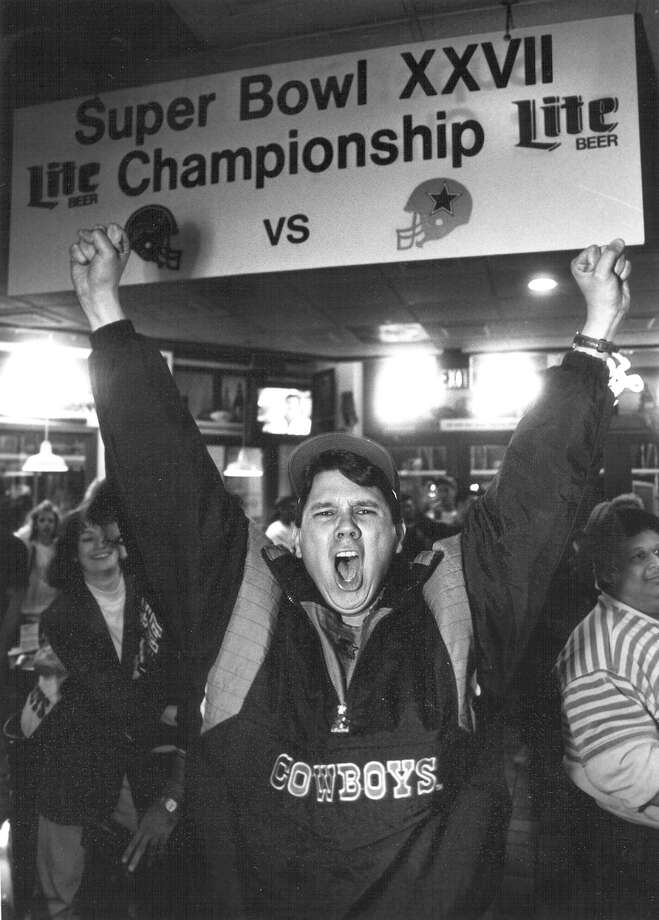 Orlando Imai celebrates the Cowboys' victory in Super Bowl XXVII at Champions in San Antonio on Jan. 31, 1993. Photo: San Antonio Express-News File Photo