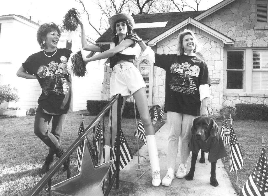 Debby Slaughter and Martha Maynard stand with Crystal, their Cowboys cheerleader mannequin, just before of the start of Super Bowl XXVII on Jan. 31, 1993. Maynard was hosting a party and decorated the inside and outside of her home. Photo: San Antonio Express-News File Photo
