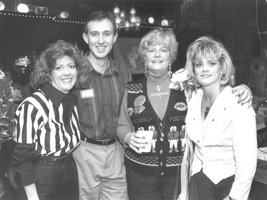 Susan Brown, Augie Pasquale, P.J. Schneider and Vanessa Hopper attend a party for Super Bowl XXVII at Old San Francisco Steak House in San Antonio on Jan. 31, 1993. Photo: San Antonio Express-News File Photo