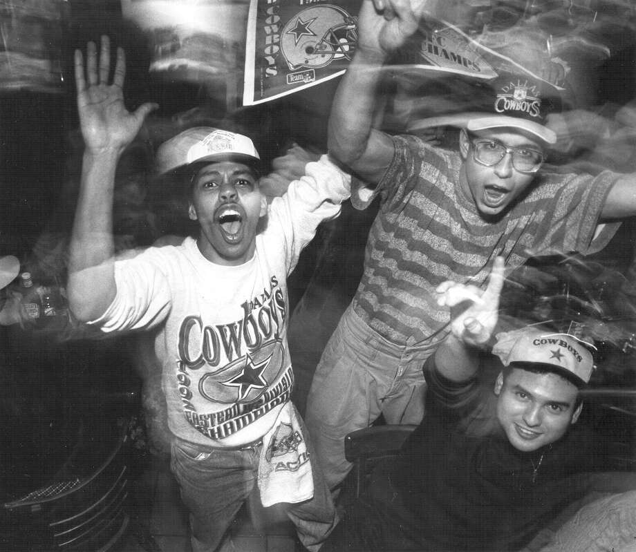 Bobby Henry and Jason Lyda celebrate the Cowboys' victory in Super Bowl XXVII at Champions in San Antonio on Jan. 31, 1993. Photo: San Antonio Express-News File Photo