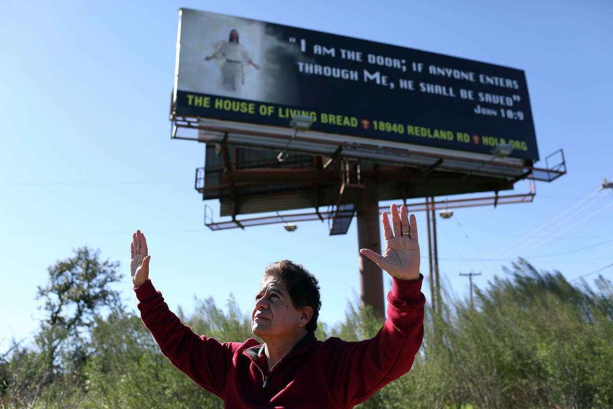 Pete Ortega stands in front of a billboard, part of a Christian billboard campaign supported by local churches and ministries, on Highway 281 north of 1604 in San Antonio on Wednesday, Jan. 30, 2013.