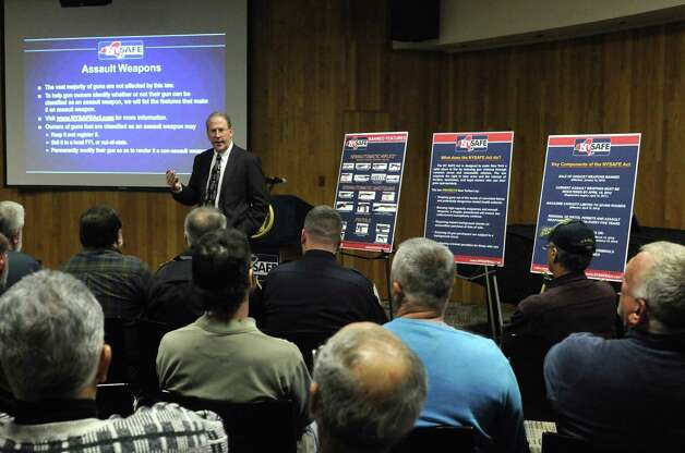 New York State Police Col. Tom Fazio speaks to an audience at the Schenectady County Public Library about the New York SAFE Act, part of a statewide outreach program on the new gun law, on Wednesday Jan. 30,2013 in Schenectady, N.Y. (Michael P. Farrell/Times Union) Photo: Michael P. Farrell