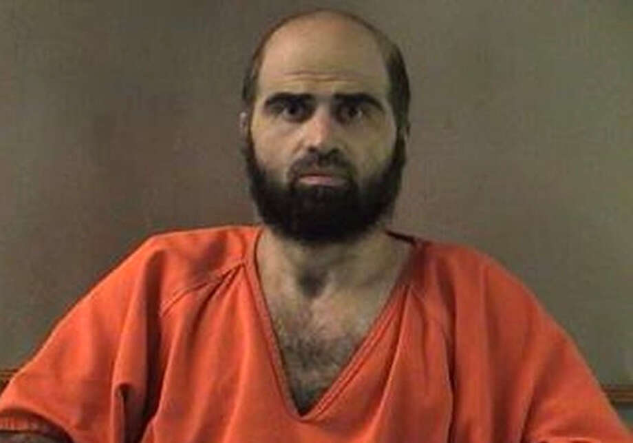 FILE - This undated file photo provided by the Bell County Sheriff's Department shows Nidal Hasan, the Army psychiatrist charged in the deadly 2009 Fort Hood shooting rampage. The new judge in the shooting case will decide next week whether to spare Hasan the death penalty and let him plead guilty. Col. Tara Osborn has set pretrial hearings for Wednesday, Jan. 30, 2013 through Friday.  (AP Photo/Bell County Sheriff's Department, File) Photo: Uncredited, HOPD / Bell County Sheriff's Department