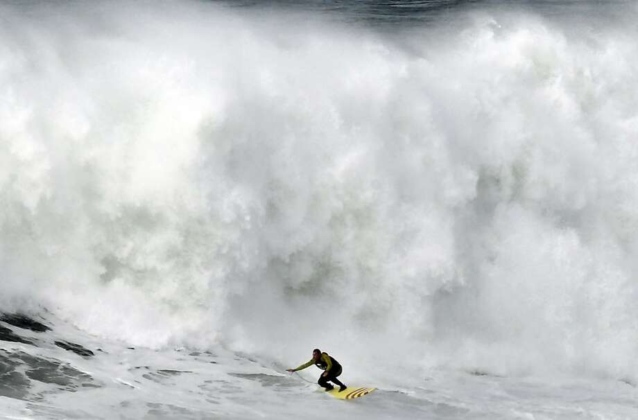 US surfer Garrett McNanamara rides a wave during a surf session at Praia do Norte beach in Nazare, Portugal, Wednesday, Jan. 30, 2013. McNamara is said to have broken his own world record for the largest wave surfed when he caught a wave reported to be around 100ft, off the coast of Nazare on Monday. If the claims are verified, it will mean that McNamara, who was born in Pittsfield, Massachusetts, USA,  but whose family moved to Hawaii's North Shore when he was aged 11, has beaten his previous record, which was also set at Nazare, of 23.77 meters (78 feet) in November 2011. Photo: Francisco Seco, Associated Press