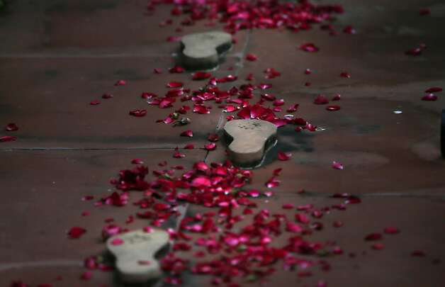 Flowers decorate the footprints that mark the last steps of Mahatma Gandhi, on his death anniversary in New Delhi, India, Wednesday, Jan. 30, 2013. Gandhi, known as the father of the nation, was assassinated by a Hindu nationalist on Jan. 30, 1948. Photo: Manish Swarup, Associated Press