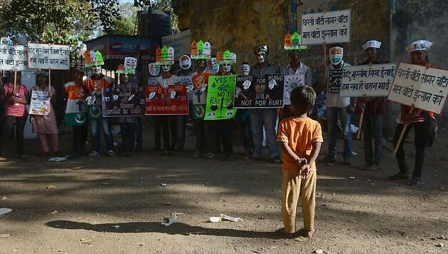 A child watches as Indian students assemble for a peace rally on the 65th death anniversary of 'father of the nation' Mahtama Gandhi, in Mumbai on January 30, 2013. Students and people from various walks of life took part in the rally for peace and communal harmony. Photo: Indranil Mukherjee, AFP/Getty Images