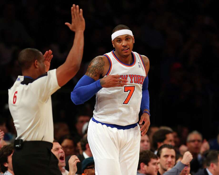 Carmelo Anthony set a Knicks record Wednesday by scoring at least 20 points in his 30th straight game. Photo: Elsa, Staff / 2013 Getty Images