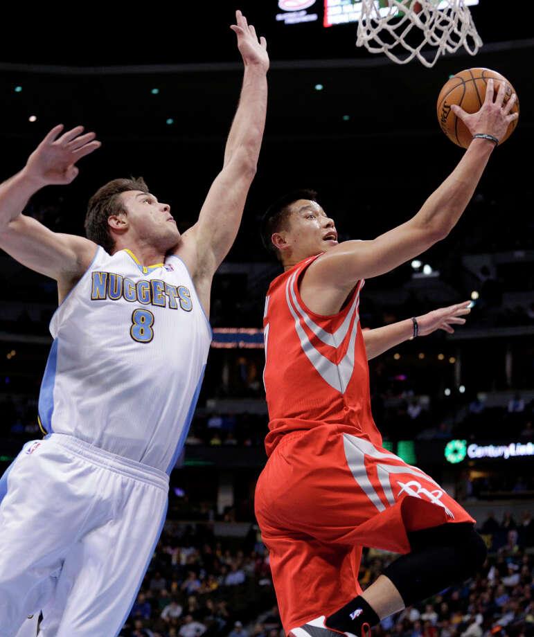 Jan. 30: Nuggets 118, Rockets 110Danilo Gallinari (8), of the Nuggets, guards Rockets guard Jeremy Lin. Photo: Joe Mahoney, Associated Press / FR170458 AP