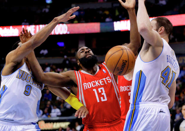 Rockets guard James Harden (13) loses the basketball between Nuggets forward Andre Iguodala (9) and center Kosta Koufos. Photo: Joe Mahoney, Associated Press / FR170458 AP