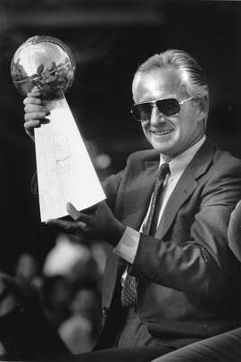 SEIFERT-29JAN1990-RINGMAN - 49'er Coach George Seifert, holding the Super Bowl trophy, in the victory parade along Market St, Jan. 29, 1990, in San Francisco, the day after the Super Bowl game.   Photo by Steve Ringman