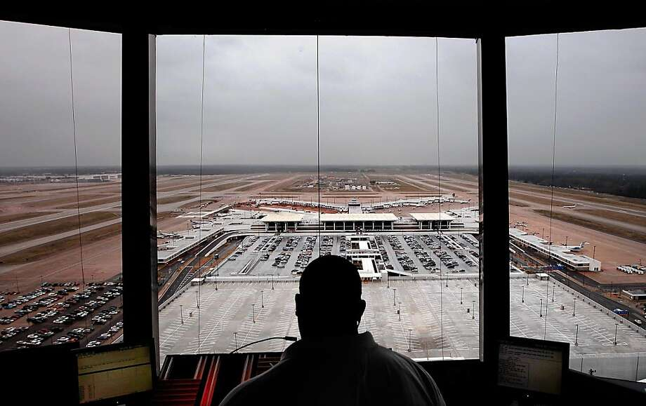 An air traffic controller watches outbound flights from the Memphis International Airport Wednesday Jan. 30, 2013 in Memphis, Tenn. A new FAA initiative called recategorization is increasing efficiency at the airport by allowing less spacing between takeoffs. Photo: Jim Weber, Associated Press