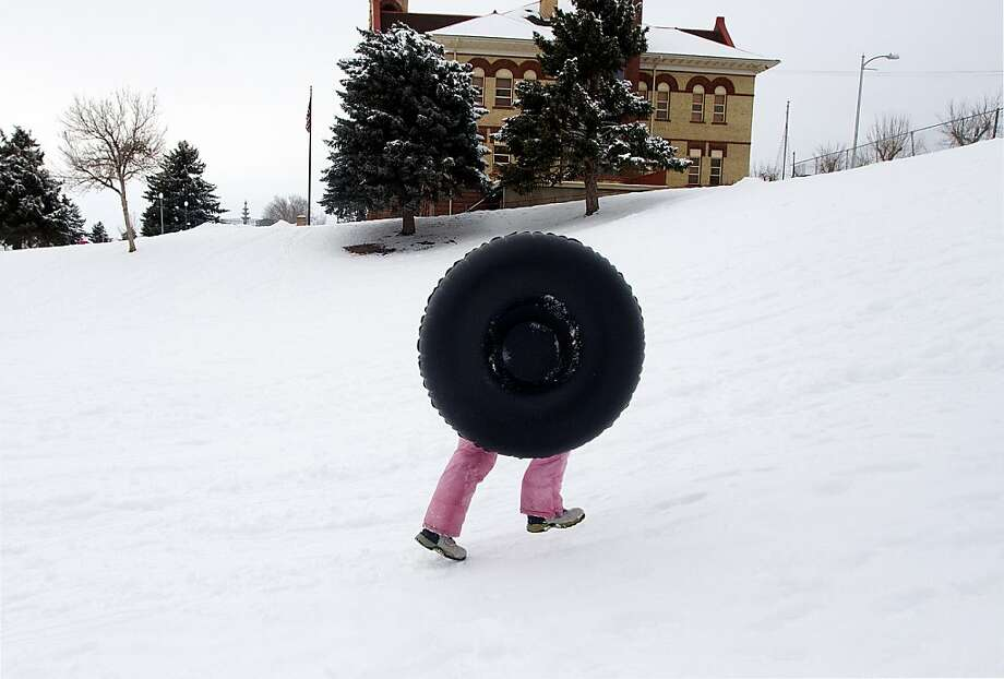 Brielle Shirley, 8, of Payson, runs up the hill after sledding down in her inner tube behind the Peteetneet Museum and Peteetneet School in Payson, Utah on Wednesday, Jan. 30, 2013. Photo: Sarah Weiser, Associated Press