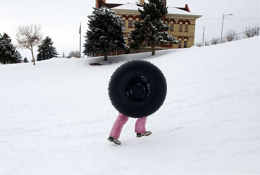 Lacking traction in the snow, a wheel sprouts two legs to climb a sledding hill in Payson, Ut