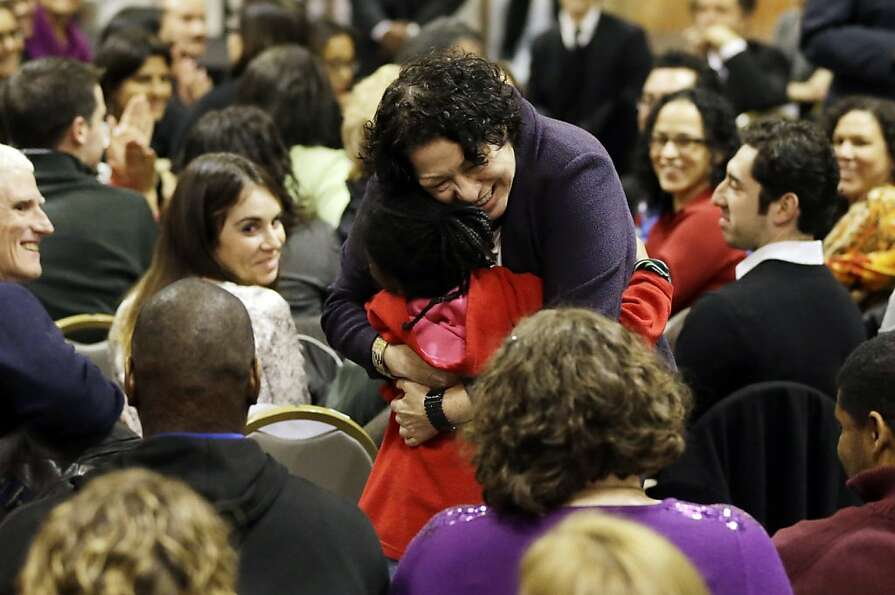 U.S. Supreme Court Justice Sonia Sotomayor, right, hugs Tabbie Major, 7, during a question and answe
