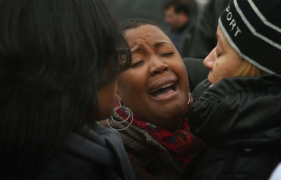 Cleopatra Cowley-Pendleton is comforted near a neighborhood park where her daughter Hadiya was killed on January 30, 2013 in Chicago, Illinois. Fifteen-year-old Hadiya was shot and killed when a gunman opened fire on her and friends in the park yesterday while they were hanging out on the warm rainy afternoon under a shelter in the park. Hadiya was a majorette in her high school band and recently performed in Washington, D.C. during the inauguration. President Obama's Chicago home is less than a mile from the park where Hadiya was killed.   Another person was wounded in the leg during the shooting. Photo: Scott Olson, Getty Images