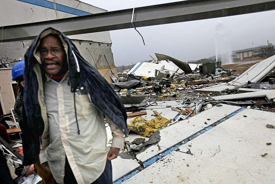 Workers look for personal belongings following a tornado at the Daiki plant, a metal fabrication company, Wednesday, Jan. 30, 2013, in Adairsville, Ga. A fierce storm system that roared across Georgia has left at least one person dead after it demolished buildings and flipped vehicles on Interstate 75 northwest of Atlanta. Photo: David Goldman, Associated Press