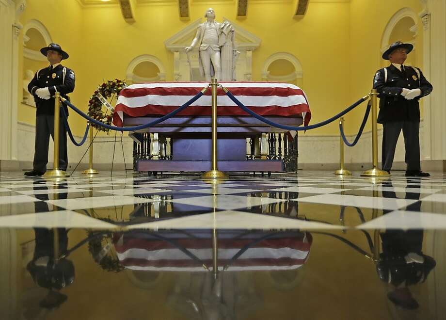 A Capitol police honor guard stand watch over the casket containing the body of former Virginia Supreme Court Chief Justice, Harry Carrico which lies in state in the rotunda of the State Capitok Wednesday, Jan. 30, 2013 in Richmond, Va.  A funeral for Carrico who died on Sunday is planned for Thursday. Photo: Steve Helber, Associated Press