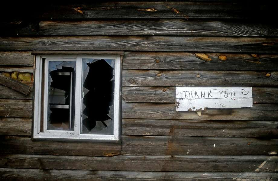 A sign hangs next to a damaged window outside a barbecue restaurant after a tornado struck, Wednesday, Jan. 30, 2013, in Adairsville, Ga. A fierce storm system that roared across Georgia has left at least one person dead after it demolished buildings and flipped vehicles on Interstate 75 northwest of Atlanta. Photo: David Goldman, Associated Press