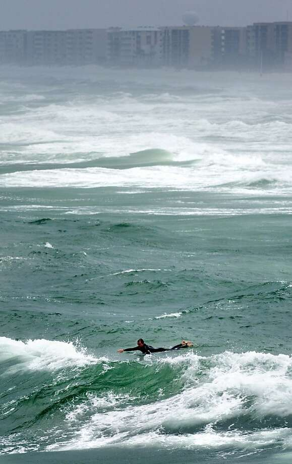 A surfer searches for the right wave in the Gulf of Mexico on Okaloosa Island in Fort Walton Beach, Fla., on Wednesday Jan. 30, 2013 as a storm moved through Northwest Florida. Photo: Devon Ravine, Associated Press