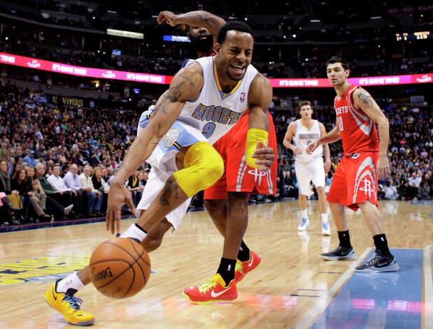 Andre Iguodala drives to the basket (9) against Rockets forward James Harden. Photo: Joe Mahoney, Associated Press / FR170458 AP