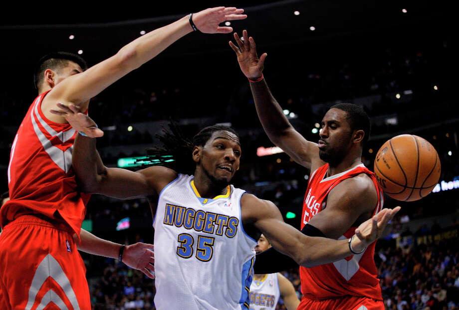 Nuggets forward Kenneth Faried (35) reaches for the ball against Rockets guard Jeremy Lin, left, and forward Patrick Patterson. Photo: Joe Mahoney, Associated Press / FR170458 AP